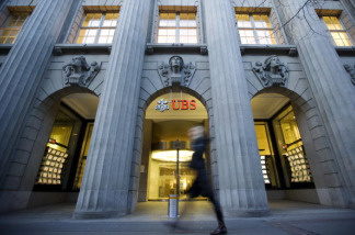 This picture shows a person walking past a building of the Swiss Bank UBS in the Bahnhofstrasse in Zurich