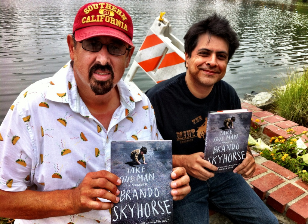 Brando Skyhorse, right, with Frank, one of his five fathers. They're posing at the Echo Park boathouse, in the neighborhood Skyhorse describes in his memoir,