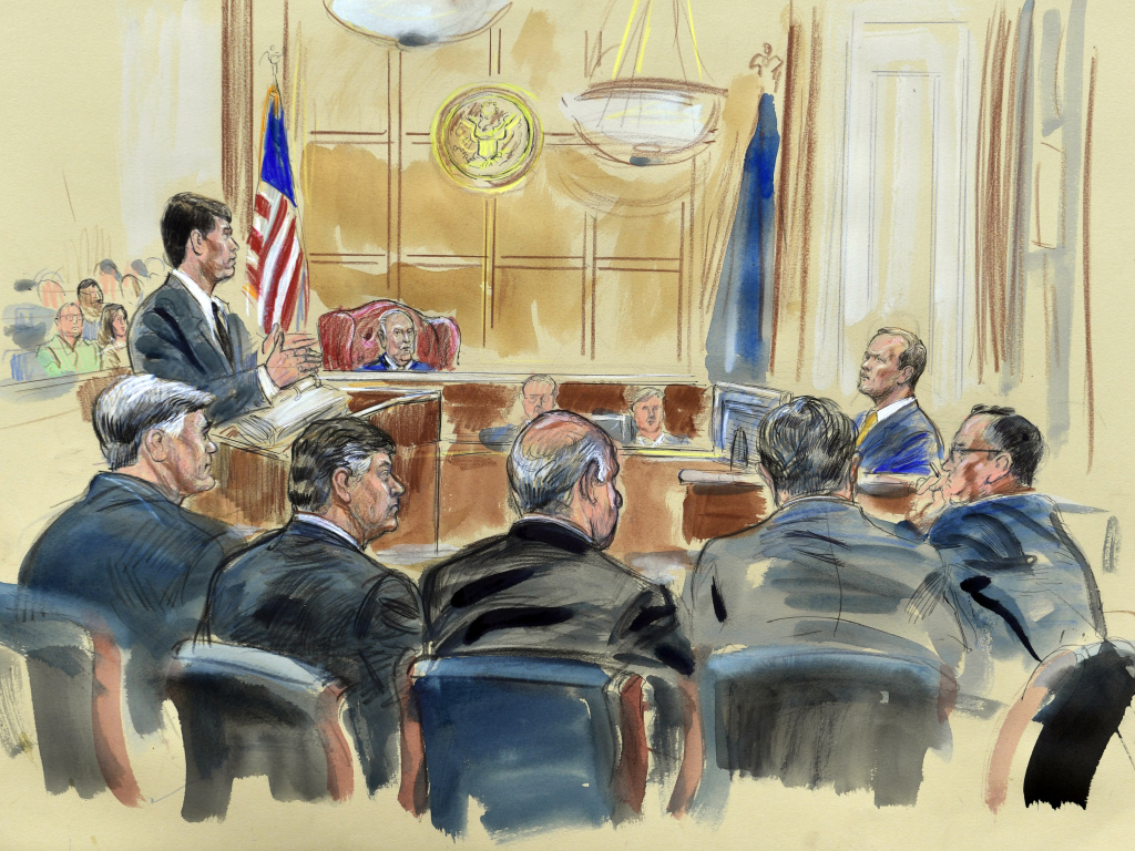 This courtroom sketch depicts Rick Gates, right, answering questions by prosecutor Greg Andres as he testifies in the trial of Paul Manafort in Alexandria, Va.
