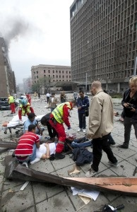 Injured people are treated by medics at the scene of an explosion near the government buildings in Norway's capital Oslo on July 22, 2011.