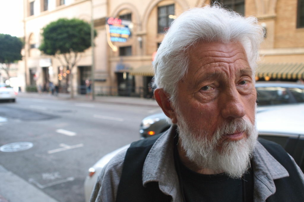 In this file photo, artist Ed Moses is pictured in Downtown L.A. with Cole's restaurant in the background.