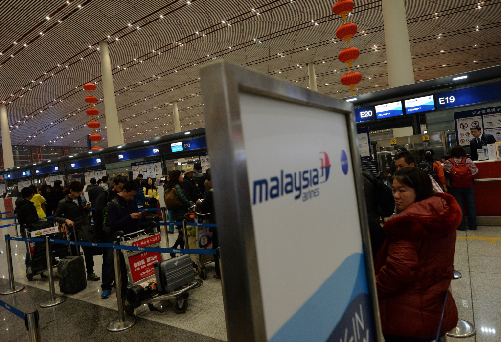 Passengers check in for a Malaysia Airlines flight from Beijing to Kuala Lumpur at China's Beijing Airport on March 10, 2014. Malaysia said a missing airliner carrying 239 people may have inexplicably turned back as authorities launched a terror probe into the plane's sudden disappearance, investigating suspect passengers who boarded with stolen passports.