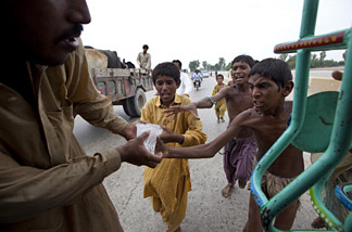 Desperate flood victims scramble for some ice donated by a local Muslim organization on August 15, 2010 in Sukkur , Pakistan. The country's agricultural heartland has been devastated as rice, corn and wheat crops have been destroyed by the floods, officials say as many as 20 million people have been effected. Pakistan is suffering from the worst flooding in 80 years as the army and aid organizations struggle to cope with the scope of the wide spread scale of the disaster which has killed over 1,600 people and displaced millions. The U.N. has described the disaster as unprecedented with over a third of the country under water.