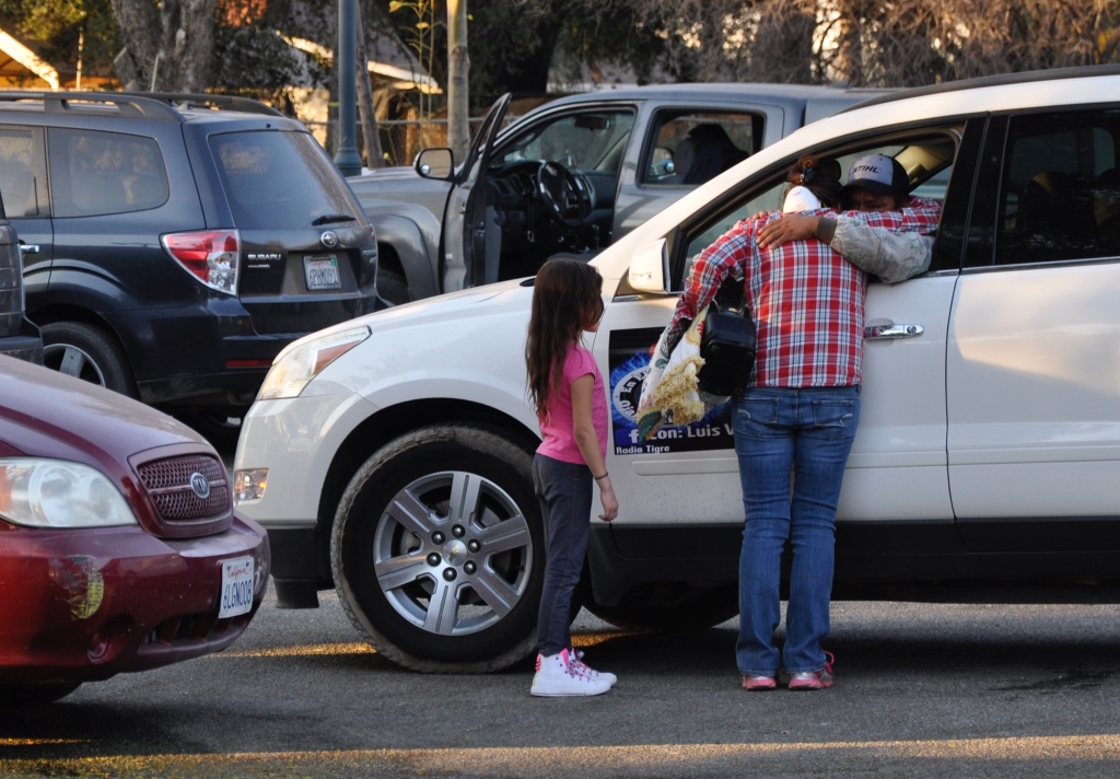 A hug in the parking lot of Stagecoach Station at an ad-hoc relief operation for Thomas Fire victims.