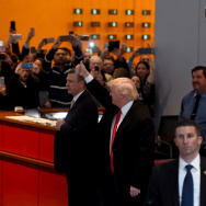 US President-elect  Donald Trump  waves to the crowd after leaving a meeting at the New York Times on November 22, 2016 in New York.
