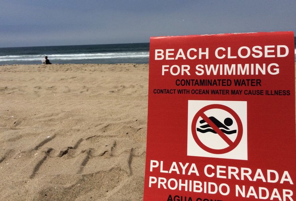 File: A closed area of Manhattan Beach on May 28,2015.