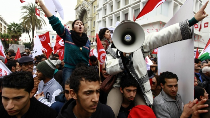 Supporters of Tunisia's secular Popular Front on Tuesday celebrate the third anniversary of the ouster of dictator Zine el-Abidine Ben Ali. The country is on the verge of approving a new constitution that was negotiated by Islamist and secular political p
