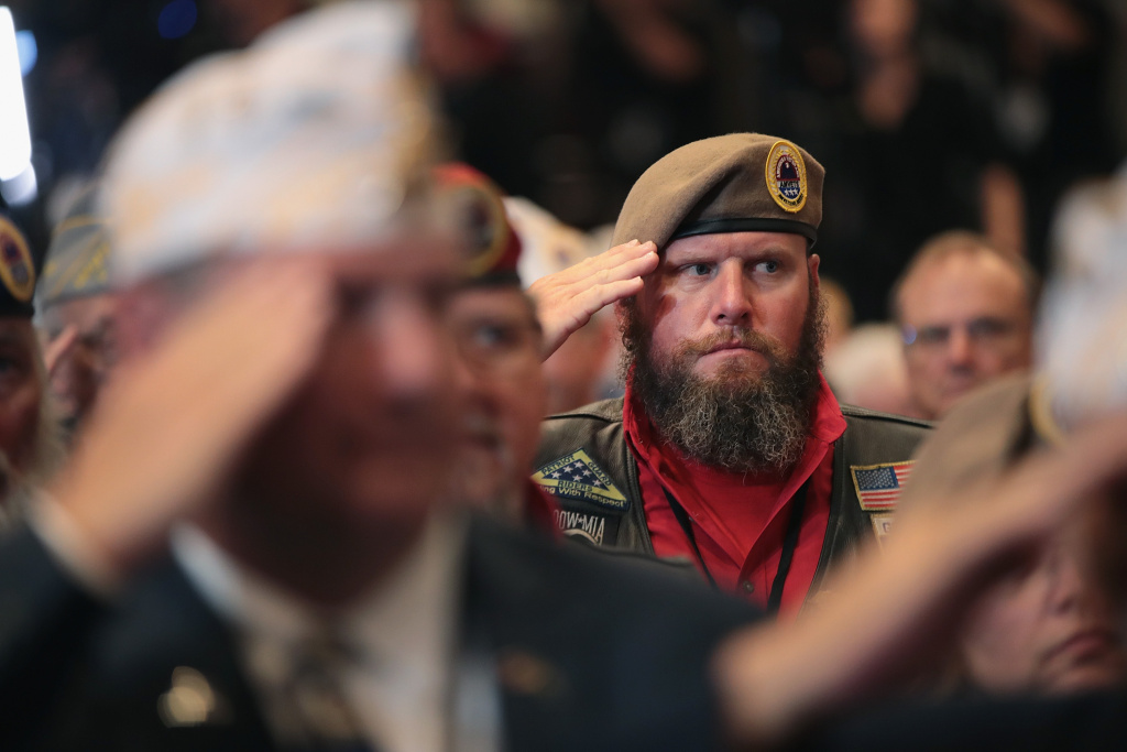 Veterans salute for the presentation of colors during the Joint Opening Ceremony at the American Veterans (AMVETS) 75th National Convention at the Galt House on August 21, 2019 in Louisville, Kentucky.