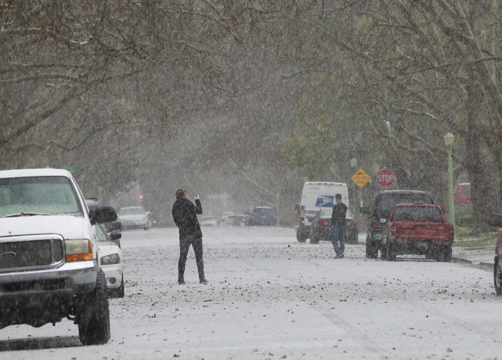 File: A sudden hail storm leaves the appearance of falling snow, Monday, Feb. 26, 2018, in Sacramento.