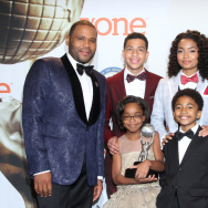 """Anthony Anderson, from left, Marcus Scribner, Marsai Martin, Yara Shahidi, Miles Brown, and Tracee Ellis Ross pose in the press room with the award for outstanding comedy series for """"Black-ish"""" at the 46th NAACP Image Awards at the Pasadena Civic Auditorium on Friday, Feb. 6, 2015, in Pasadena, Calif. (Photo by Arnold Turner/Invision/AP)"""
