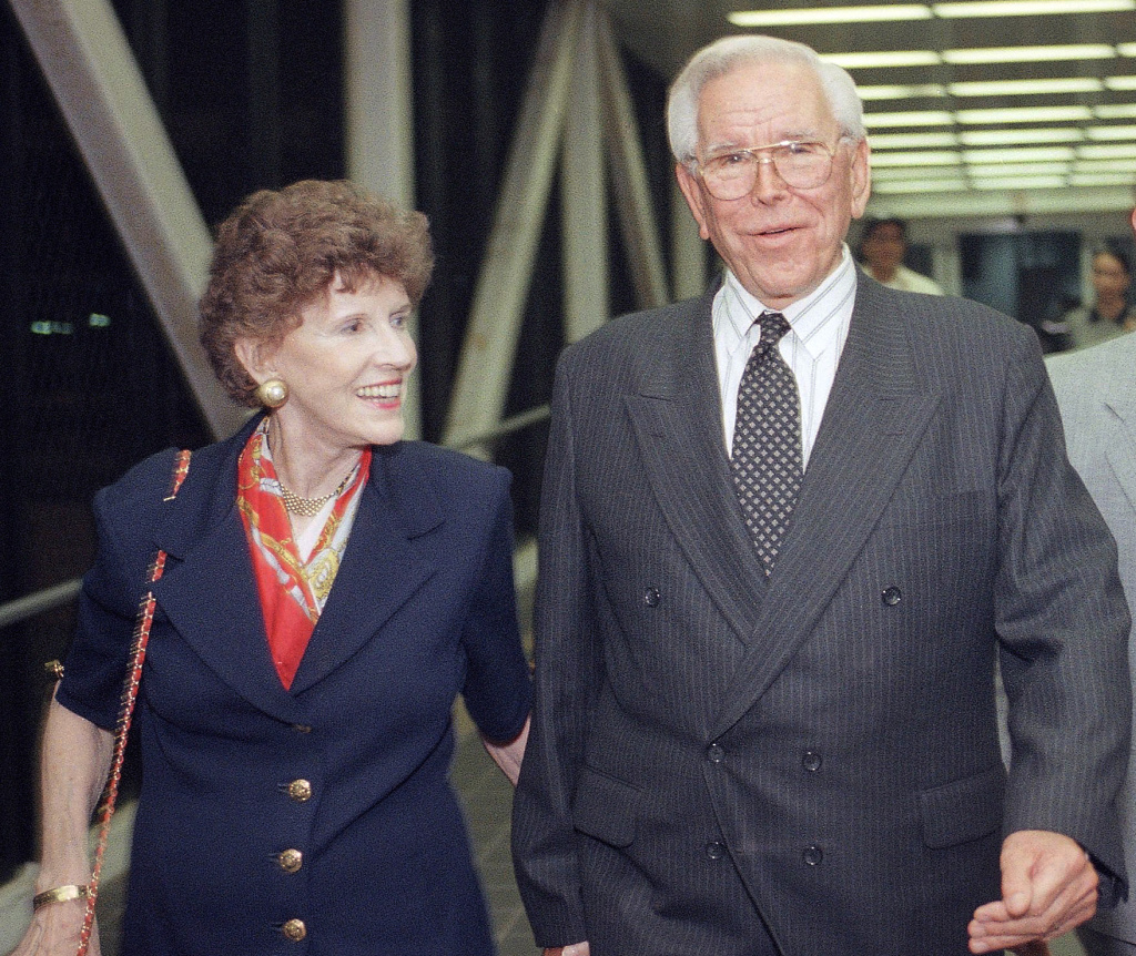 This Aug. 13, 1997 file photo shows the Rev. Robert Schuller of the Crystal Cathedral, and his wife, Arvella at Los Angeles International Airport. Dr. and Mrs. Robert H. Schuller announced their resignation from the board of directors of the Crystal Cathedral Ministries that they founded 42 years ago, 15 years after starting the Garden Grove Community Church.