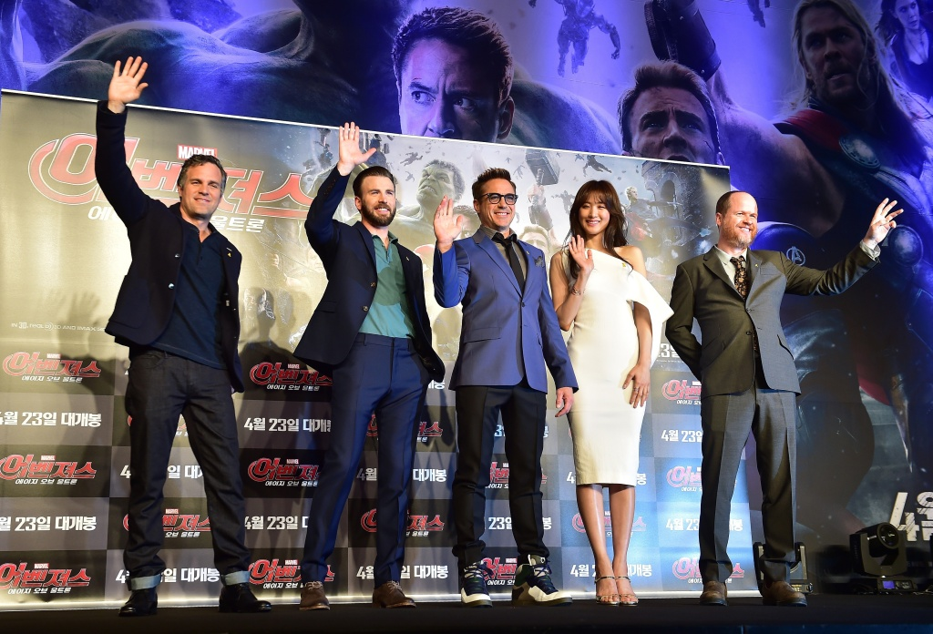Mark Ruffalo, Chris Evans, Robert Downey Jr, Kim Soo-Hyun and director Joss Whedon pose for a photo session during a press conference to promote Marvel's