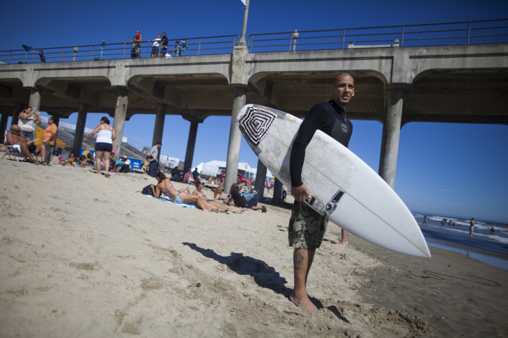 Daniel Lopez checks the surf at Huntington Beach. The scaled-down U.S. Open of Surfing set to start this weekend is a good thing, Lopez said. The event will return to the roots of the contest, which should be about surfing instead of a raging party, he said.