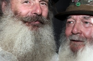 Two bearded men pose ahead of the 26th International Alpine Beard Competition on August 21, 2011 in Chur, Switzerland.