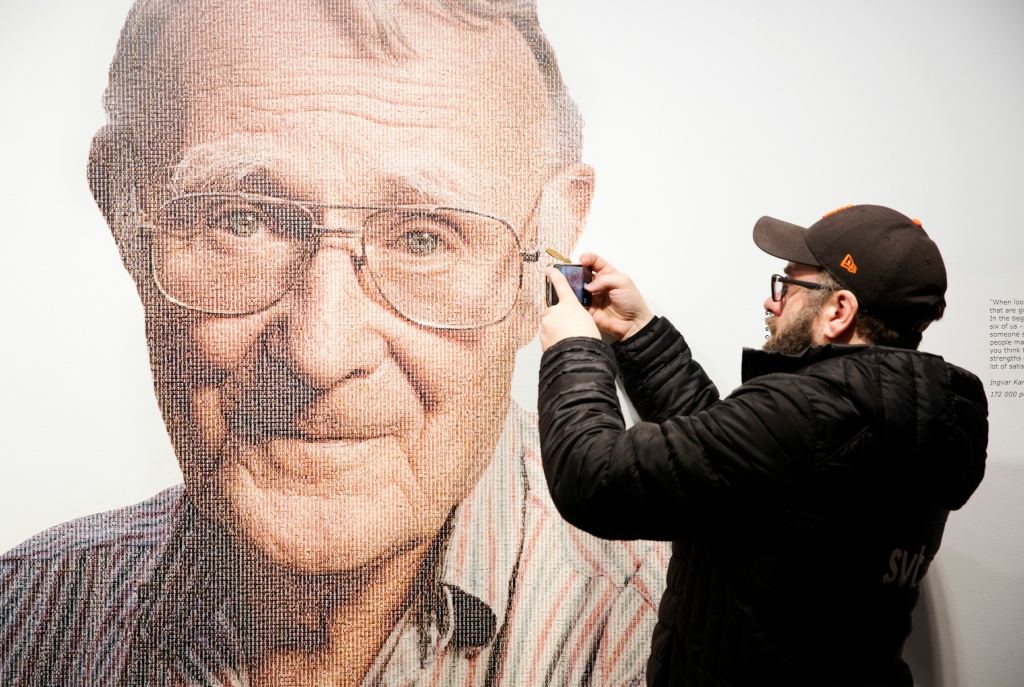 A visitor takes a mobile photo of a picture of Ingvar Kamprad, founder of Swedish multinational furniture retailer IKEA, at the IKEA museum in Almhult, Sweden, on January 28, 2018.