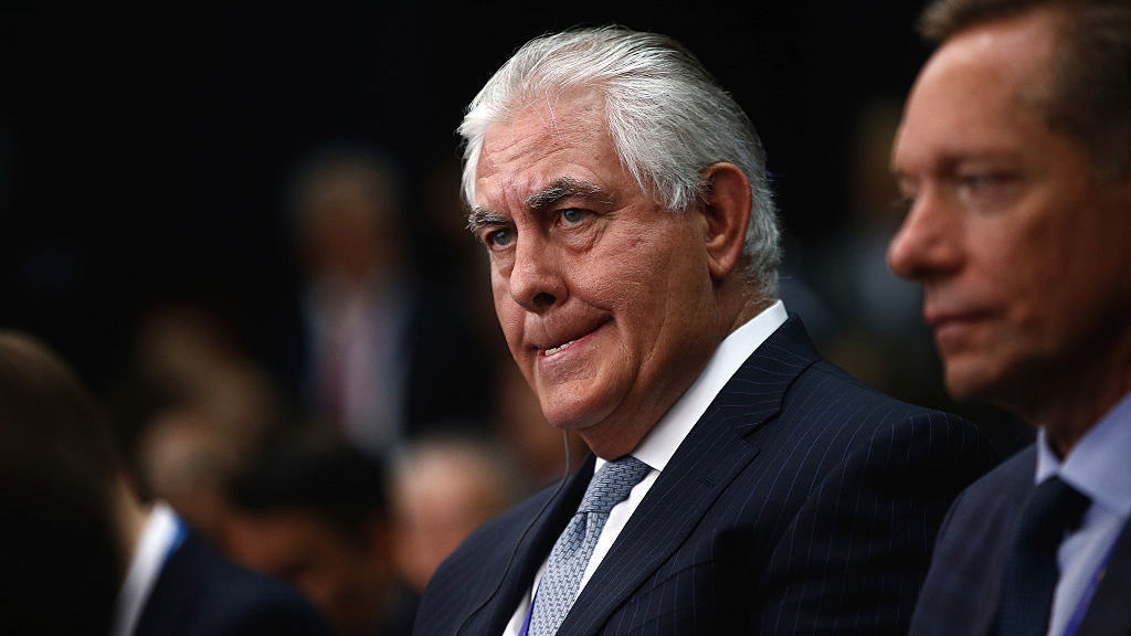 Rex Tillerson, chief executive officer of Exxon Mobile Corp., left, listens on the opening day of the St. Petersburg International Economic Forum this past June.
