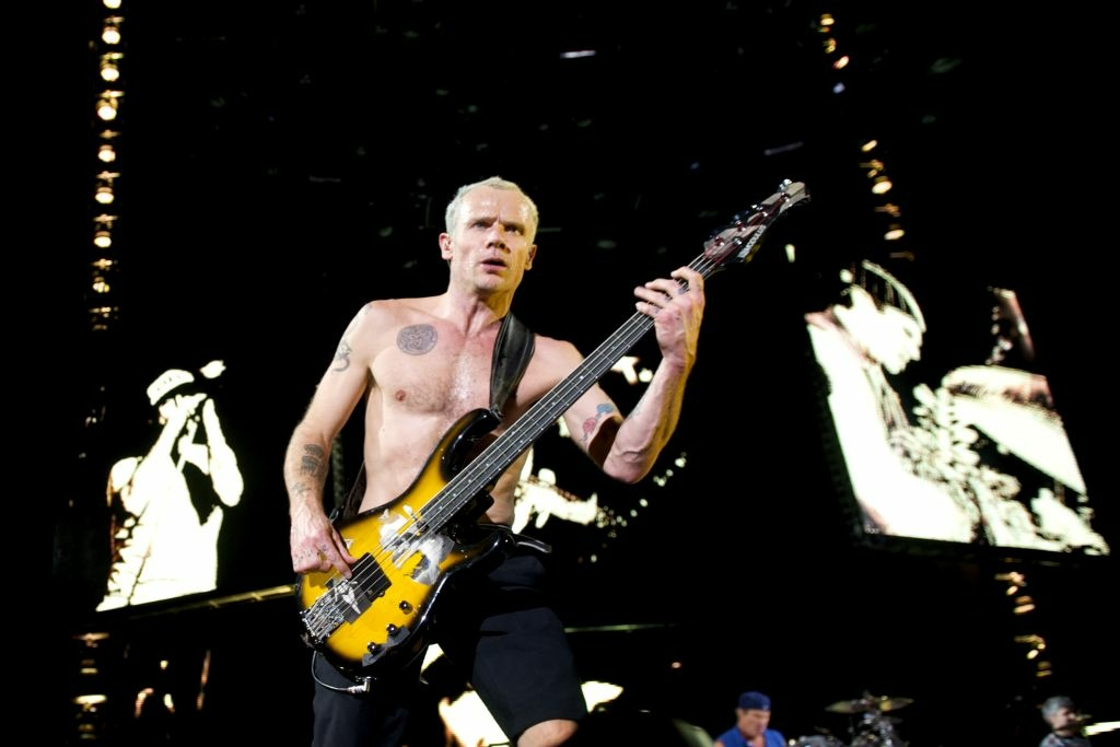 Flea of Red Hot Chili Peppers performs at Palacio de los Deportes on December 17, 2011 in Madrid, Spain.