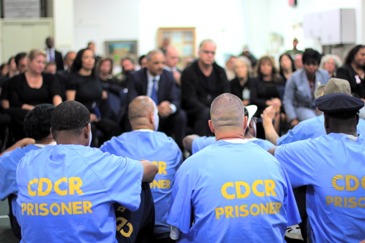 Attorney General Eric Holder watches a performance of the Actor's Gang Prison Project at the California Rehabilitation Center in Norco, California