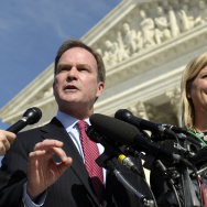 Michigan Attorney General Bill Schuette speaks to reporters after arguing the case before the U.S. Supreme Court in October. He's with XIV Foundation CEO Jennifer Gratz, who was a plaintiff in a lawsuit against the University of Michigan's affirmative act