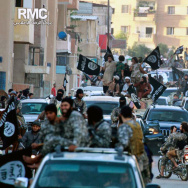 Fighters from the Islamic State group parade in Raqqa, northern Syria. The U.S. is considering arming Arab and Kurdish fighters who are poised to attack the Islamic State stronghold.