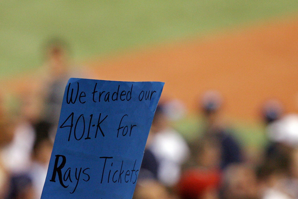 A fan of the Tampa Bay Rays holds up a sign which reads
