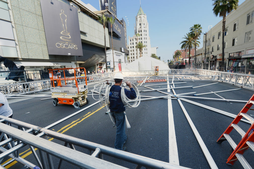 A worker carries building materials on Hollywood Boulevard in preparation for the 85th Academy Awards ceremony, February 18, 2013 in Hollywood, California. A section of Hollywood Boulevard in front of the Dolby Theatre will be closed for the entire week as crews build press risers and fan bleachers and roll out the red carpet for the Academy Awards ceremony, which will take place on February 24 in the Dolby Theatre.