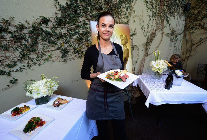 In this file photo, Lucques chef Suzanne Goin holds a vegan plate which she prepared and to be served at the 19th annual SAG Awards during food and wine tasting event at Lucques Restaurant on January 16, 2013 in Los Angeles, California. Goin has won a 2016 James Beard award for outstanding chef. Together with Dahlia Narvaez's win for her work as pastry chef at Osteria Mozza, Goin's victory is a sign West Coast culinary work is earning its due.