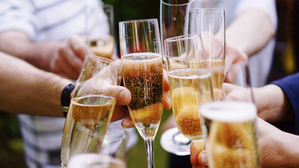 File photo of friends toasting with champagne.