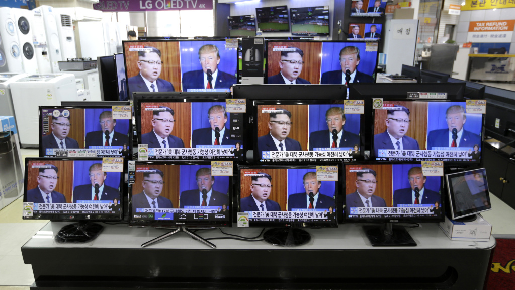 TV screens in a Seoul, South Korea, store show news coverage of the latest exchange of insults between President Trump and North Korean leader Kim Jong Un.
