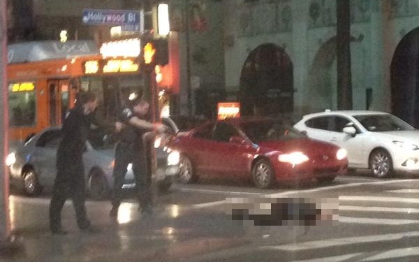 An eyewitness photo of a man who was shot at the Hollywood and Highland intersection by police on Friday, Dec. 5, 2014. (The man has been pixelated due to the graphic nature of the photo. This photo has also been cropped.)