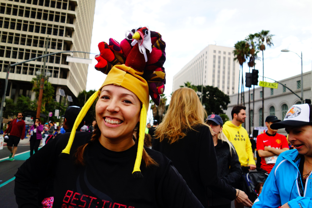 Jazmin Ortega models a turkey hat crafted for her by her sister. Ortega said the legs flapped in her face while running in the Nov. 28, 2013, Turkey Trot LA. in downtown Los Angeles.