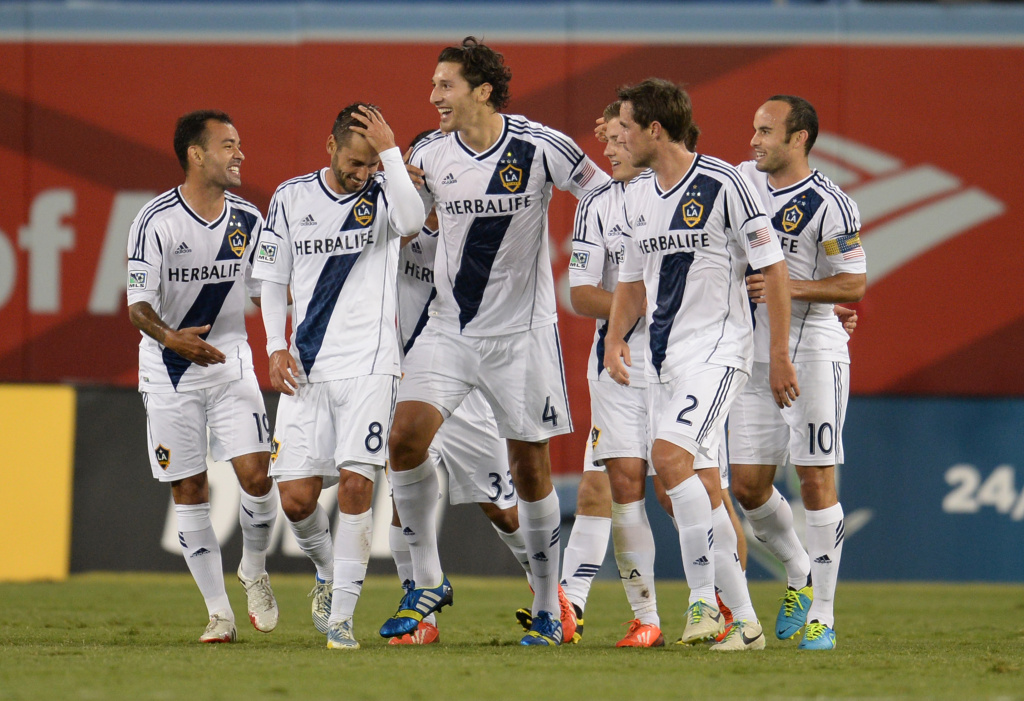 Los Angeles Galaxy's Omar Gonzalez (C-#4) celebrates with teammates after scoring the first goal against Italian football side Juventus at the Guinness International Champions Cup at Dodgers Stadium in Los Angeles on August 3, 2013. The LA Galaxy defeated Juventus 3-1. Gonzalez is playing on the U.S. Men's National Team in the 2014 World Cup.