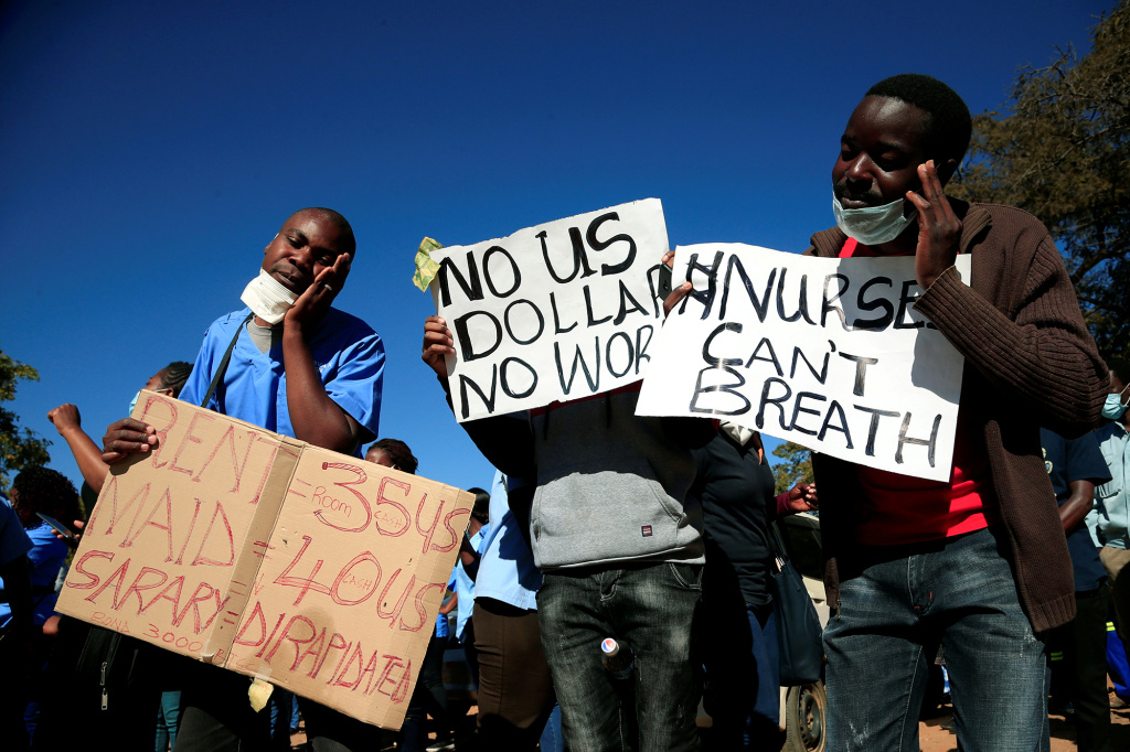 Health workers protest against economic hardship and poor working conditions during the COVID-19 outbreak in Harare, Zimbabwe.
