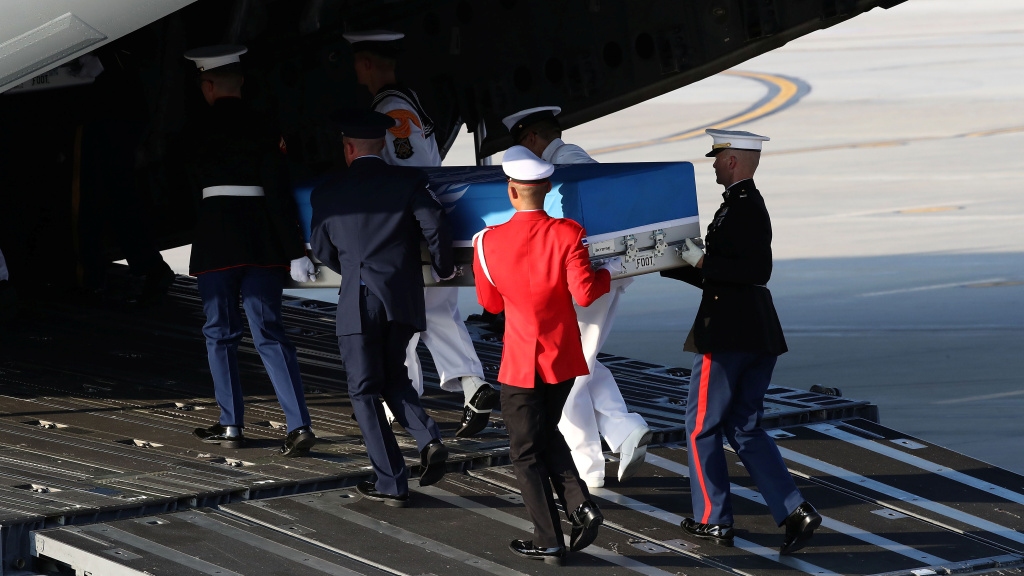 U.N. honor guards carry a casket containing remains transferred by North Korea onto a plane at Osan Air Base in Pyeongtaek, South Korea, on Wednesday. The remains will be analyzed in Hawaii to determine whether they are those of U.S. service members missing since the Korean War.