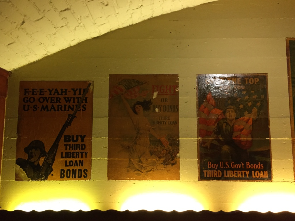 These war bonds posters have been affixed to the wall since the last 1920s.