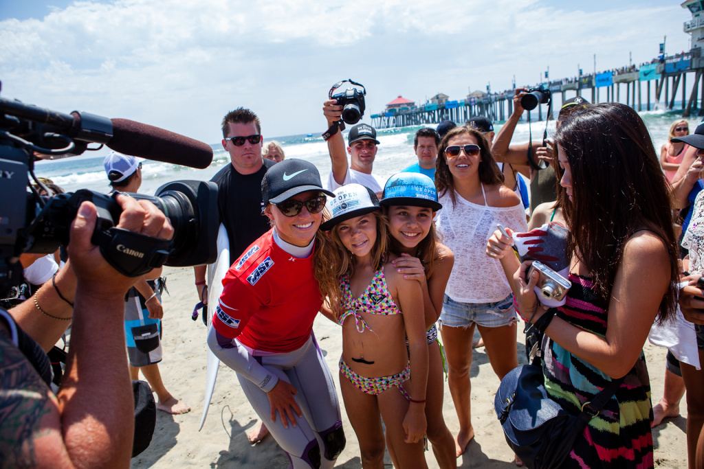 Lakey Peterson, a Santa Barbara, CA native, poses with fans on Friday, August 3. Peterson went on to win the women's pro division on Sunday.