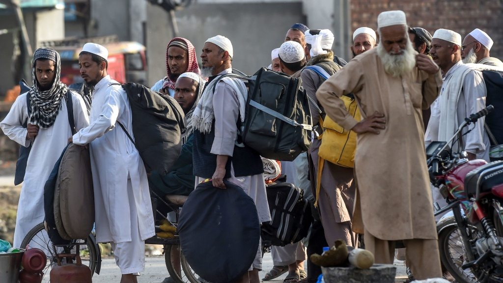 Tablighi Jamaat members prepare to leave after a mass religious gathering outside Lahore on March 13.