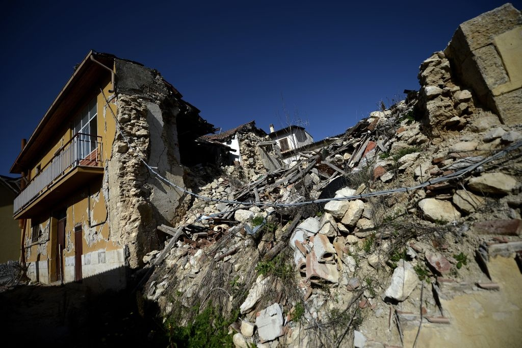 This picture shows damaged building following the 2009 earthquake on October 22, 2012 in the village of Onna. Six Italian scientists and a government official were found guilty the same day of multiple manslaughter for underestimating the risks of a killer earthquake in L'Aquila in 2009, and sentenced to six years in jail in a watershed ruling in a case that has provoked outrage in the international science community.