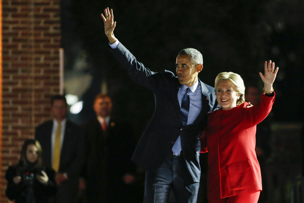 US Democratic presidential nominee Hillary Clinton (R) and US President Barack Obama wave to the crowd after a rally on the final night of the 2016 US presidential campaign at Independence Mall in Philadelphia, Pennsylvania, November 07, 2016.