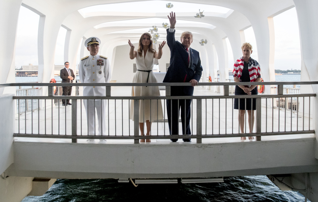 President Trump and first lady Melania Trump, accompanied by Adm. Harry Harris (left) and his wife, Bruni Bradley, throw flower pedals while visiting the Pearl Harbor Memorial in Honolulu, Hawaii, last Nov. 3. Trump has nominated Harris to be the U.S. ambassador to South Korea.