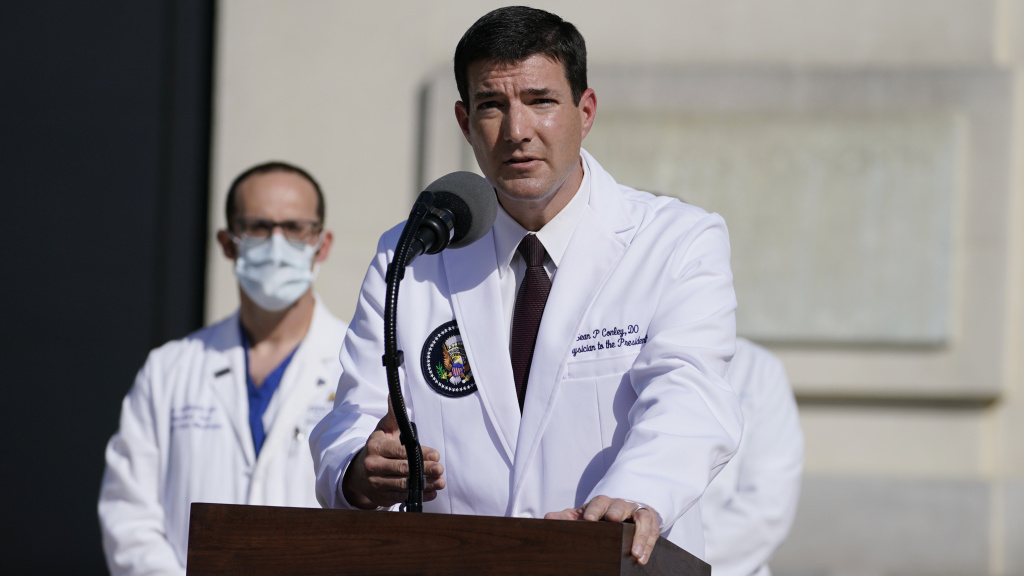 Dr. Sean Conley, physician to President Trump, talks with reporters at Walter Reed National Military Medical Center on Monday.