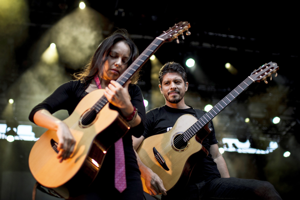 Mexican musicians Gabriela Quintero and Rodrigo Sanchez from 'Rodrigo y Gabriela' duo, perform on stage on July 14, 2012, as part of the 'Nuits de Fourvieres' music festival.