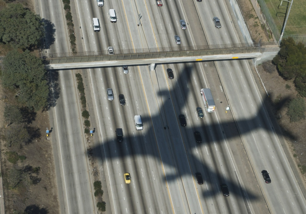 In this file photo, the shadow of Air Force One with US President Barack Obama aboard appears on a freeway upon final approach to Los Angeles International Airport in Los Angeles, California, October 9, 2014. Obama has visited California some two dozen times during his presidency. He was scheduled to make another stop on Thursday, June 18, 2015.