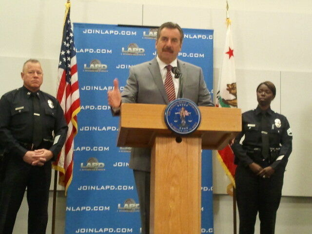 LAPD Chief Charlie Beck speaks to reporters at Police Headquarters in downtown Los Angeles. Police Captain Phil Tingirides (LA) and Tingirides' wife Emada (R), who is also an LAPD officer, were among those threatened in the Dorner online manifesto.