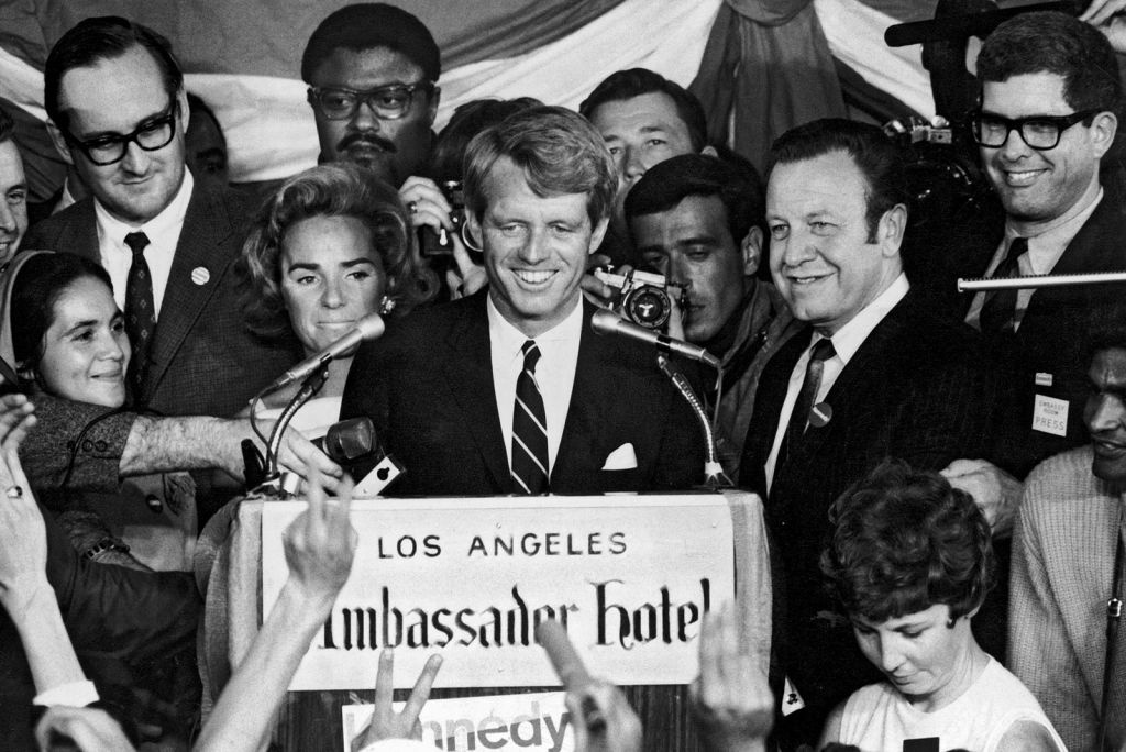 Robert F. Kennedy's speech at the Ambassador Hotel, moments before he was fatally shot. Sandi Gibbons is the woman in the white dress at the bottom right.