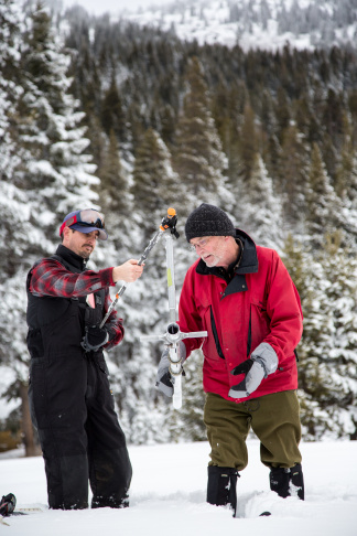 From left, John Paasch (California Department of Water Resources, Chief of Flood Operations), and Frank Gehrke (California Department of Water Resources, Chief of Snow Surveys) conduct a manual snow survey on Jan. 3, 2017 at Phillips Station, Calif., just off Highway 50 near Sierra-at-Tahoe Road approximately 90 miles east of Sacramento.