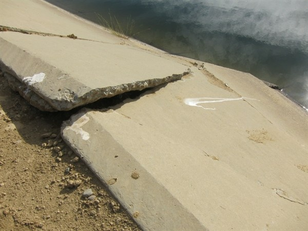 Cracks and buckle along Delta Mendota Canal.