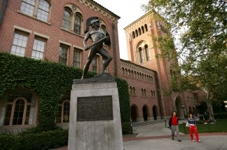 Students walk across the campus of the University of Southern California.