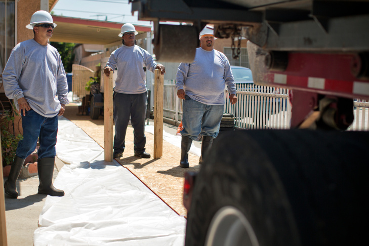 Exide begins to remove lead-polluted soil on Monday morning at a house on the 1200 block of La Puerta Street in Boyle Heights.