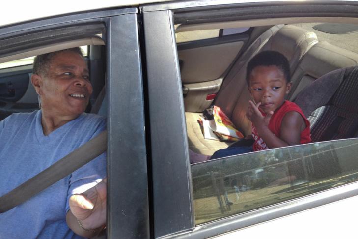 Harvesha Knight plays with her children Darniyah Davis and Darryl Jr. Davis. Harvesha is pursuing her nursing degree, but has had to put off school because her local preschool hasn't opened its doors this school year.